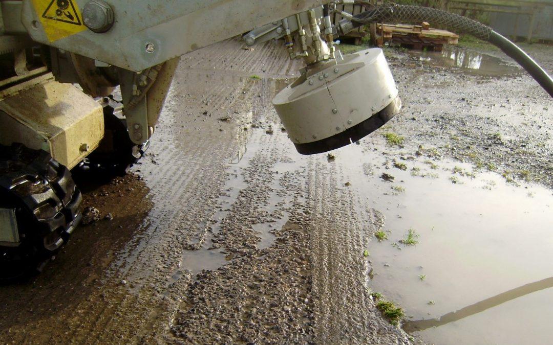 concrete scabbling machine vs handheld scabbler